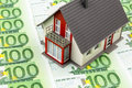 House on banknotes bills symbolic photo for home purchase financing building society Stock Images