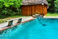 House bench next to pool shot sodwana bay kwazulu natal province southern mozambique area south africa Stock Image