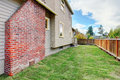 House with brick chimney and fenced backyard Royalty Free Stock Photo