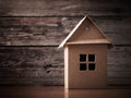 House in brown recycled paper on wooden background Stock Images
