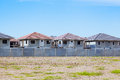 House Building and Construction Site village in progress, waitin Royalty Free Stock Photo