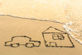 House and a car drawing on the beach sand with soft wave Royalty Free Stock Images