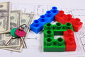 House of colorful building blocks, keys and banknotes on drawing Royalty Free Stock Photo