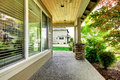 House covered porch with large window. Royalty Free Stock Photo