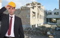 House demolition businessman with construction helmet in front of a Royalty Free Stock Photo