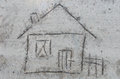 House drawing on sand close up to Royalty Free Stock Photo