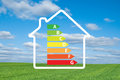 House and energy efficiency graph on meadow a Stock Photo