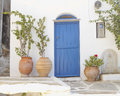 House entrance with flowerpots in a mediterranean island Stock Photo