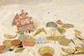 House and euro coins in the sand disappearing Stock Image