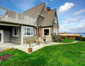 House exterior with backyard view beautiful walkout deck and of pocch chairs and walkway Stock Photography