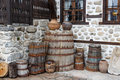 House exterior decoration old wooden barrels and stones as of an of the Royalty Free Stock Image