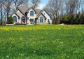 House with field Stock Photography