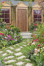 House with flower garden Royalty Free Stock Photo