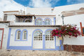 House with flowers in Algarve region, Portugal Royalty Free Stock Photo