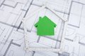 House in folding ruler on blueprint Royalty Free Stock Photo