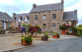 House in the french brittany with courtyard and flowers on a cloudy day Stock Photos