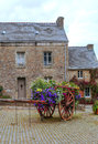 House in the french brittany with courtyard and flowers on a cloudy day it s a vertical picture Royalty Free Stock Images