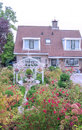 House with garden and flowers Royalty Free Stock Photo