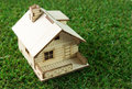 House on green grass little model the Stock Image