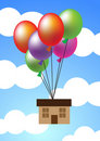 House hanging up with balloons Royalty Free Stock Image
