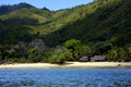 House hill navigable lagoon froth cloudy and coastline in madagascar nosy be Stock Photos