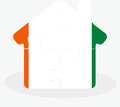 House home icon with ivory coast flag in puzzle illustration of isolated on white background Royalty Free Stock Photo