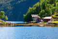 House and huts on the shore of Bergen fjord. Royalty Free Stock Photo