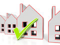 House icons with tick showing house for sale or building Stock Photo