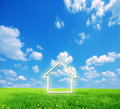 House imagination on green land Royalty Free Stock Photography