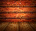 House interior grunge brick wall and wood floor Royalty Free Stock Images