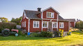 House at island harstena in sweden red cottages and tractor on the principally known for the seal hunting that was once carried Royalty Free Stock Photography
