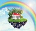 House on island with rainbow Royalty Free Stock Photo