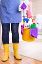 House keeper with cleaning equipment in bucket Royalty Free Stock Photo