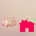 House with key and banknotes Royalty Free Stock Photo