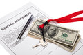 House key and cash with rental agreement real estate investment finance concept Stock Photography