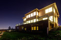 House with lights on. NIght view Royalty Free Stock Photo