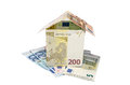 House made from euro bills isolated Royalty Free Stock Photo