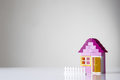 House made of kids building bricks shot in the studio on white perspex background Royalty Free Stock Photo