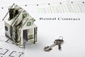 House made of money and the keys to a new home on rental contract Royalty Free Stock Photography