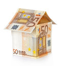 House made of money on a white Royalty Free Stock Photo