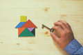 House made from tangram puzzle and key Royalty Free Stock Photo