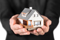 House in man s hands insurance and protection concept Stock Photography