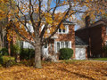 House with maple tree and fall colors Royalty Free Stock Photo