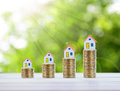 House model and coin money,mortgage and real estate investment. Royalty Free Stock Photo