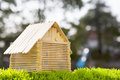 House model make from wood stick on artificial gra grass field with blurry background use for home nad housing abstract Stock Photography