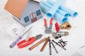 House model and tools on the blueprint for house Royalty Free Stock Image