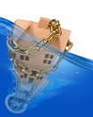 House and money going down plug conceptual illustration of chained hole in blue water Stock Image
