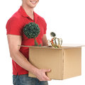 House moving happy young man carrying a cardboard box with stuff Royalty Free Stock Image