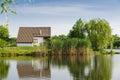 House next to the lake. Royalty Free Stock Photo
