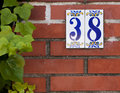 House number brass two on a red brick wall Stock Image